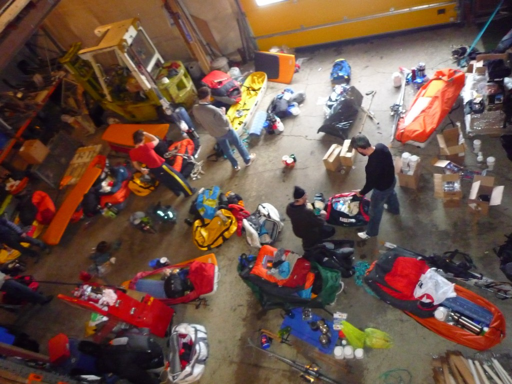 Preparation of sleds at the airport hanger