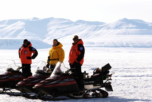 The team out on snowmobiles